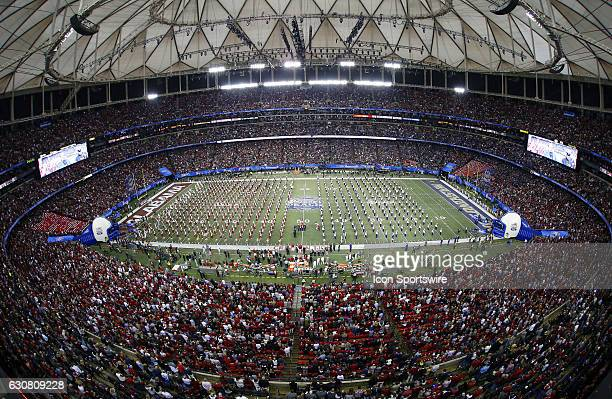 The marching bands of both schools prior to the start of the ChickfilA Peach Bowl game between the Alabama Crimson Tide and the Washington Huskies on...