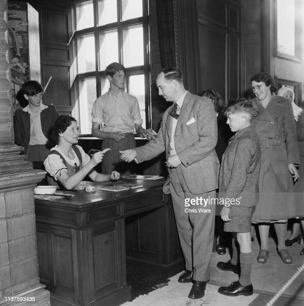 The Marchioness of Bath Daphne Fielding sells tickets to visitors at Longleat House near Warminster Wiltshire 22nd April 1949 Longleat is the seat of...