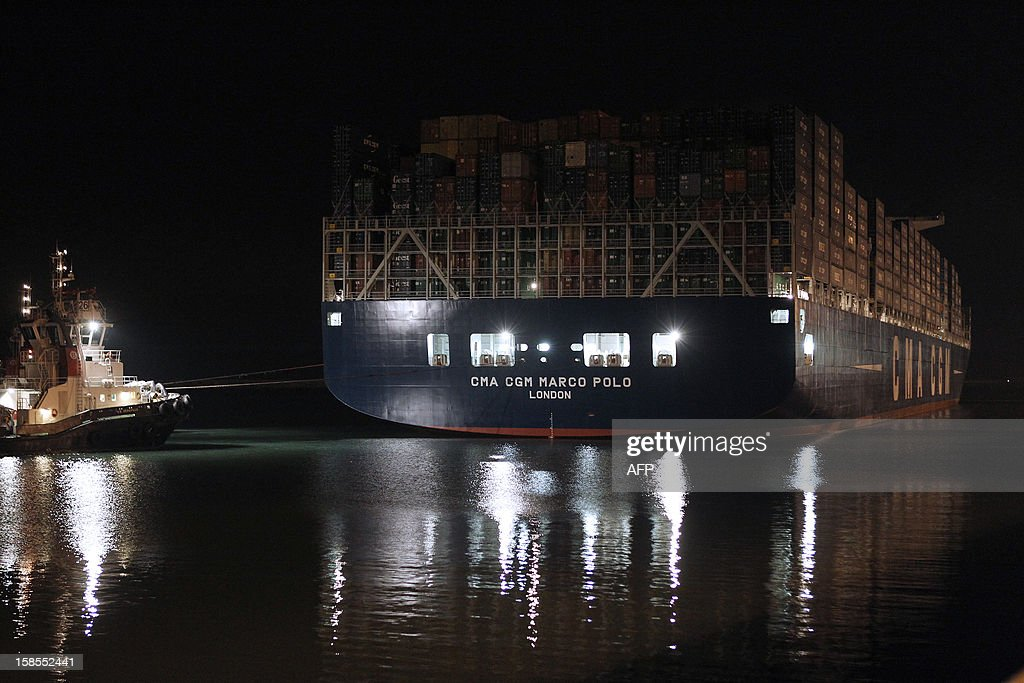 The Marco Polo, flying a British flag and said to be the world's biggest container ship by French owners CMA CGM, is towed into the port of Le Havre, western France, early on December 19, 2012. The Marco Polo was given its champagne christening in the Belgian port of Zeebrugge on December 18, 2012. The ship, which is 396 metres (yards) long -- the length of four football fields -- was built in South Korea and was to head back to Asia after a stop in France. It is said to be the largest container in the world measured by capacity, as it can hold 16,020 TEU (twenty-foot equivalent unit containers) -- or 97 kilometres of containers lined up one by one.