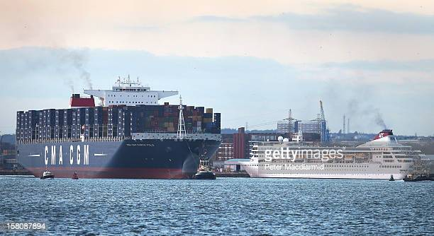 The Marco Polo, the world's biggest container ship, towers over the Braemar cruise liner as she leaves Southampton docks on December 10, 2012 in...