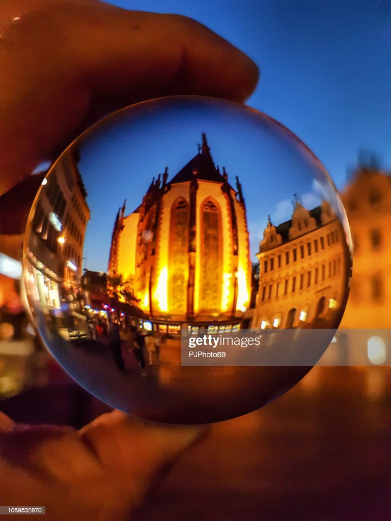 The Maria Chappel (Marienkapelle) in Wurzburg through a lensball : Stock Photo