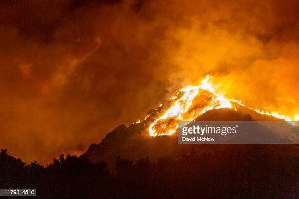 The Maria Fire burns on a hillside as it expands up to 8,000 acres on its first night on November 1, 2019 near Somis, California. Southern California...
