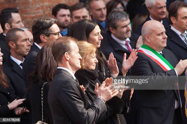 The Maria Franca the widow of Michele Ferrero escorted by his son Giovanni exit from the church at the funeral of the founder of Ferrero on February...