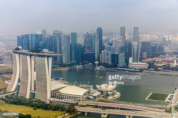 The Marina Bay Sands hotel and casino front left and the ArtScience Museum front center stand in front of commercial buildings in the central...