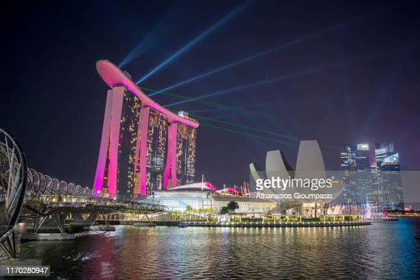 The Marina Bay Sands with The ArtScience Museum illuminated at night on August 18, 2019 in Singapore. Photo by Athanasios Gioumpasis/Getty Images)