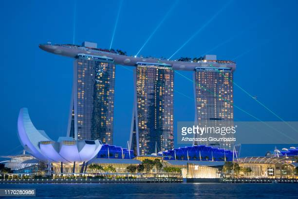 The Marina Bay Sands with The ArtScience Museum illuminated at night on August 19, 2019 in Singapore.
