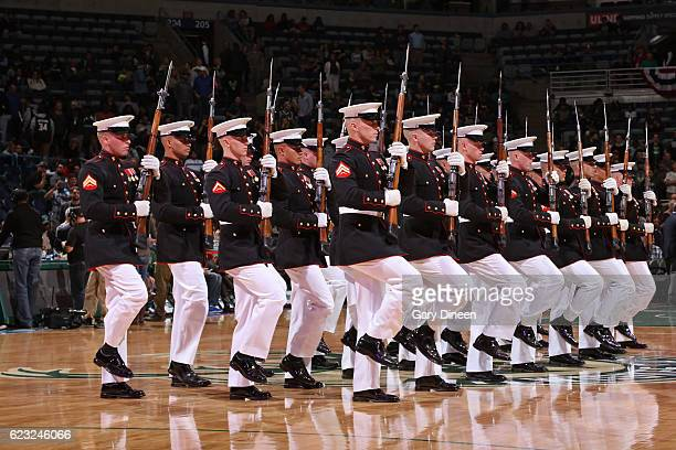 The Marine Corp colorguard performs during halftime between the Milwaukee Bucks and the New Orleans Pelicans on November 10 2016 at the BMO Harris...