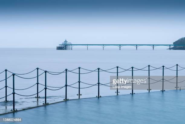 The Marine Lake at Clevedon with the Victorian pier in the Severn Estuary beyond.