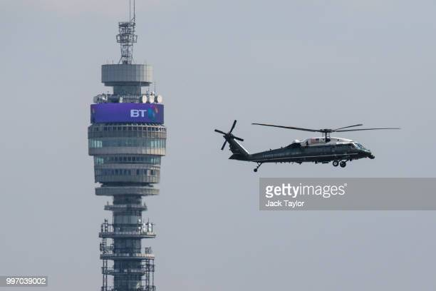 The Marine One helicopter carrying US President Donald Trump and First Lady Melania Trump flies past the BT Tower before landing at Winfield House...