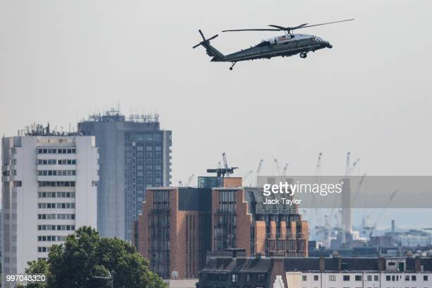 The Marine One helicopter carrying US President Donald Trump and First Lady Melania Trump flies over London before landing at Winfield House the...