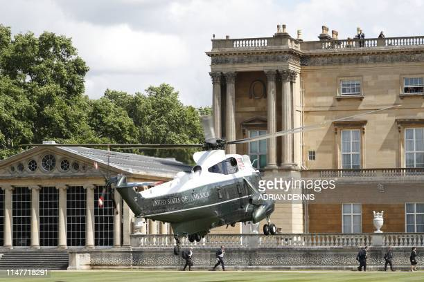 The Marine One helicopter is seen as it comes in to land carrying US President Donald Trump and US First Lady Melania Trump arriving to attend a...