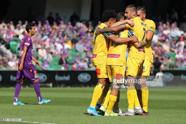 The Mariners celebrate a goal by Daniel De Silva during the round four ALeague match between the Perth Glory and the Central Coast Mariners at HBF...