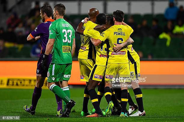 The Mariners celebrate a penality goal by Roy O'Donovan of the Central Coast Mariners during the round one ALeague match between the Perth Glory and...