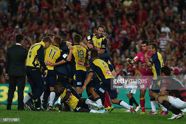 The Mariners celebrate after they defeated the Wanderers during the ALeague 2013 Grand Final match between the Western Sydney Wanderers and the...