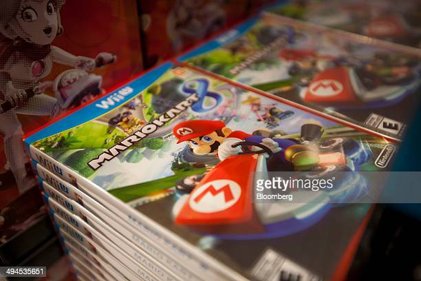 The Mario Kart 8 video game is displayed during the release at Nintendo World in New York US on Thursday May 29 2014 Nintendo Co's Mario Kart 8 which...