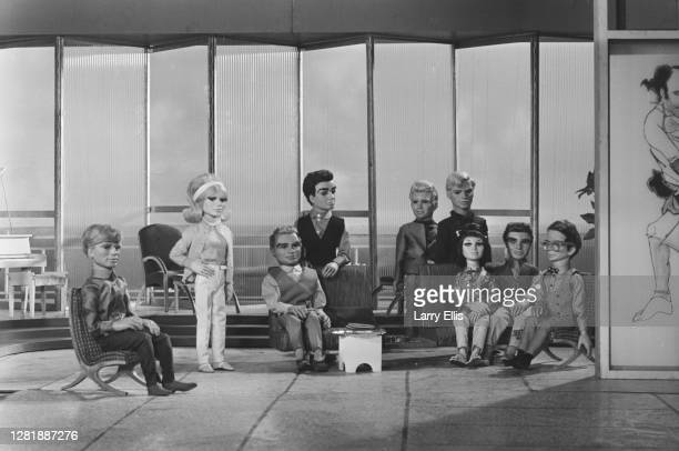 The marionettes from the 'Thunderbirds' science fiction television series, UK, 1st September 1965. From left to right, the characters are Gordon...