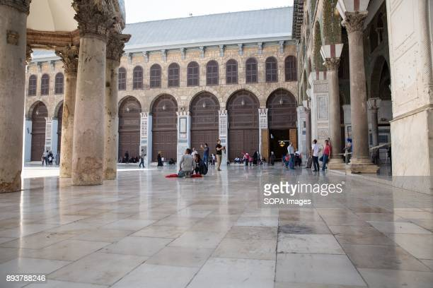 The mark left by a mortar fired from oppositionheld suburbs can be seen during Friday prayers in Damascus' Umayyad Mosque Despite the ongoing...