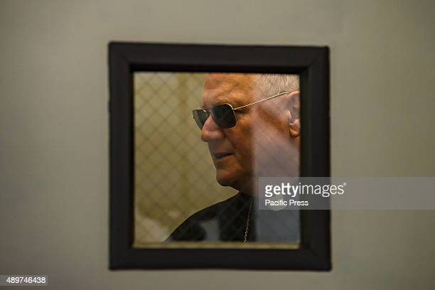 The markedly public Cardinal Dolan awaits the start of the press conference standing by a door to St Anthony's Residence Mayor Bill de Blasio and...