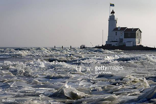 The Marken lighthouse in northern Holland is seen surrounded by icerocks caused by the recent cold weather on January 2 2009 Icerocks have been the...