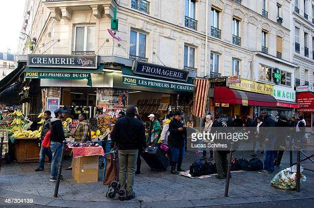 The market Dejean in popular neighborhood Barbes is also the place for sellers of fake bags to work without a permit in Paris on October 17 2013...