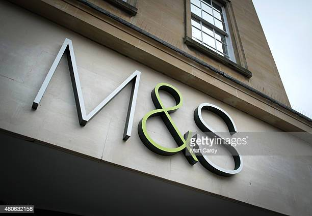 The Marks and Spencer logo is seen on the exterior of a branch on December 18 2014 in Bath England With less than a week until Christmas traditional...