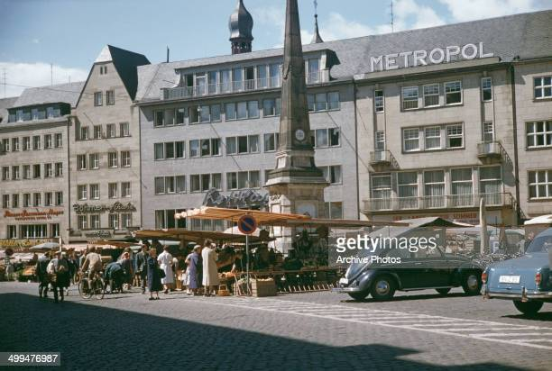 The Marktfontaine or Marktbrunnen in the Markt or marketplace in Bonn Germany 1958 Behind it is the Metropol an Art Deco cinema
