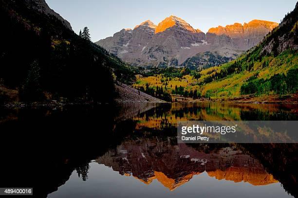 The Maroon Bells as seen from Maroon Lake near sunrise on September 20, 2015 in Aspen, Colorado.