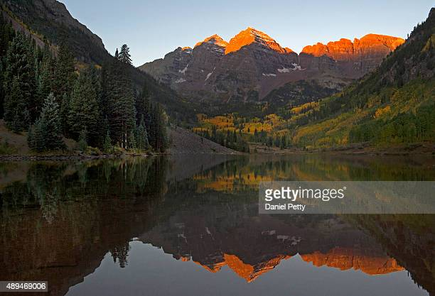 The Maroon Bells as seen from Maroon Lake near sunrise on September 20 2015 in Aspen Colorado