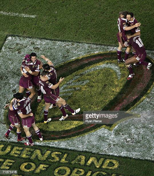 The Maroons celebrate after game three of the ARL State of Origin series between the New South Wales Blues and the Queensland Maroons at the Telstra...