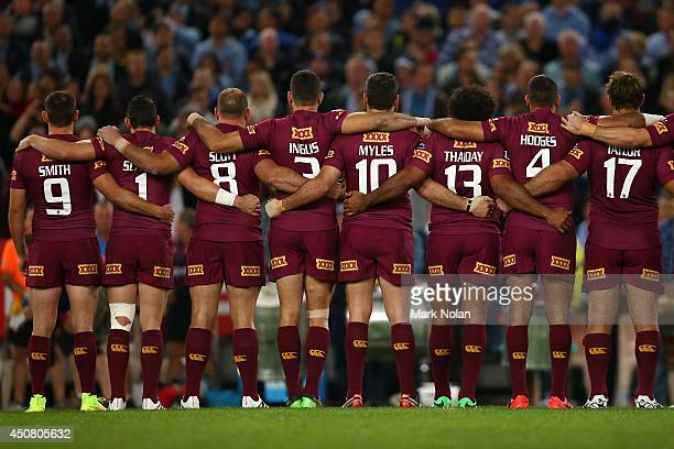 The Maroons line up and sing the national anthem before game two of the State of Origin series between the New South Wales Blues and the Queensland...