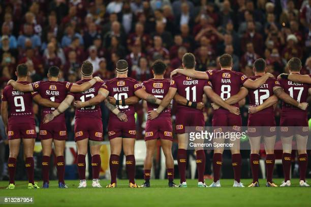 The Maroons lineup and sing the National Anthen before game three of the State Of Origin series between the Queensland Maroons and the New South...