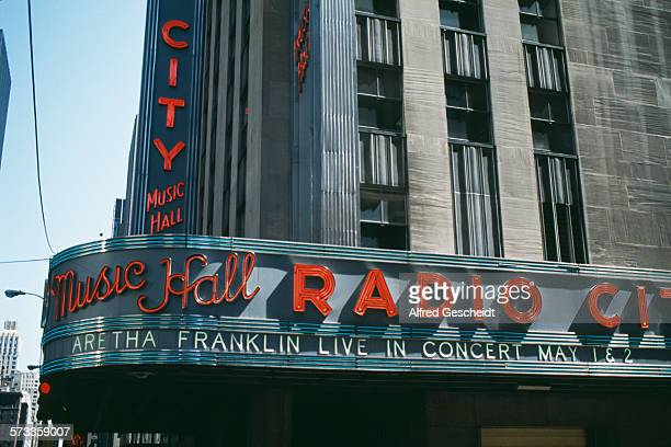 The marquee at the Radio City Music Hall in the Rockefeller Center New York City advertises a live concert by Aretha Franklin 1993