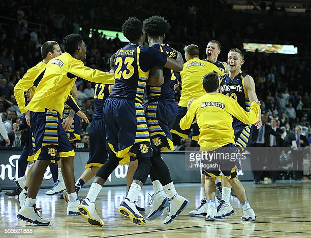 The Marquette Golden Eagles react after defeating Providence Friars 6564 on January 5 at the Dunkin' Donuts Center in Providence Rhode Island