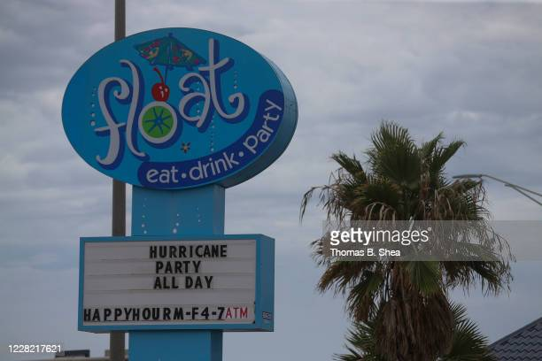 The marquis of Float on Seawall Boulevard reads Hurricane Party All Day and notes that happy hour continues as Hurricane Laura approaches on August...