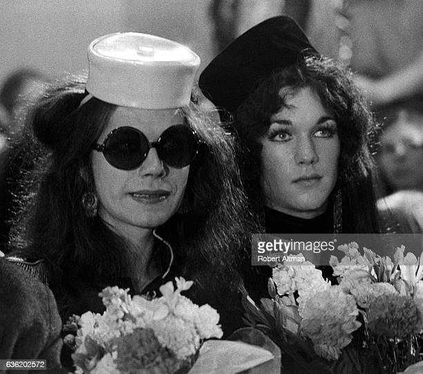 Rumi and Johnny of the Cockettes look on during a show on May 1 1971 in San Francisco California