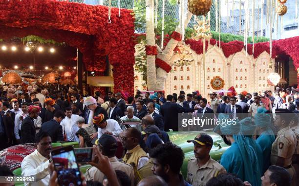 The marriage procession of Indian businessman Mukesh Ambani's daughter Isha Ambani is seen outside their house in Mumbai on December 12 2018 Topping...