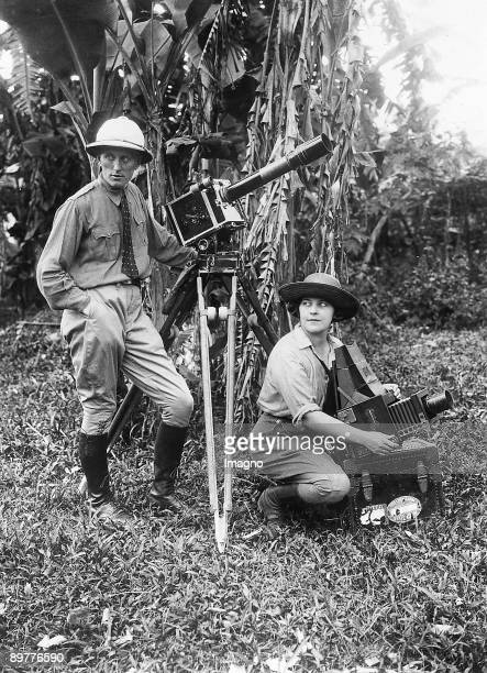 The married couple Lou Hutt on their expedition in the jungle of Borneo The photography shows the couple with their camera equipment Photograph...
