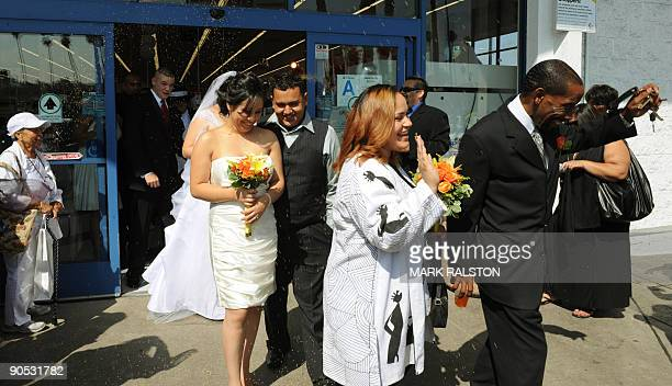 The married couples leave after their 99 cent wedding ceremonies at the 99 cent store in Los Angeles on September 9 2009 The budget supermarket chain...