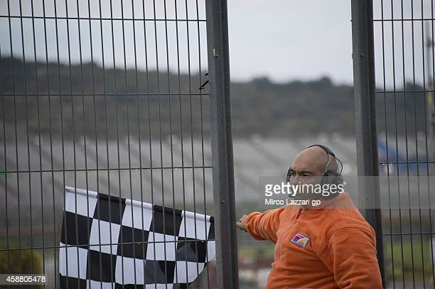 The marshall with the flag in pit during the MotoGP Tests in Valencia at Ricardo Tormo Circuit on November 11 2014 in Valencia Spain