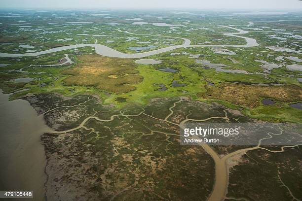 The marshy landscape surrounding Newtok is seen from a plane on June 29 2015 outside Newtok Alaska Newtok which has a population of approximately of...