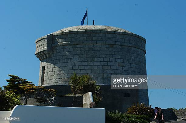 The Martello Tower perched on the edge of the Sandycove coastline is pictured in Dublin 25 June 2004 The city is hosting a worldclass fivemonth long...
