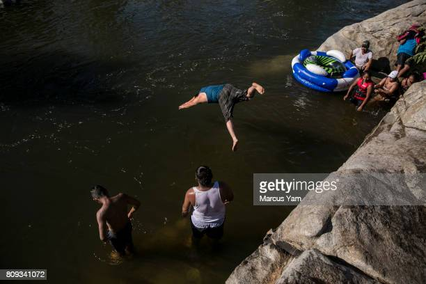 The Martinez Bererra family from Los Angeles play in the Kern River at Keyesville Camp near Lake Isabella Calif on July 3 2017