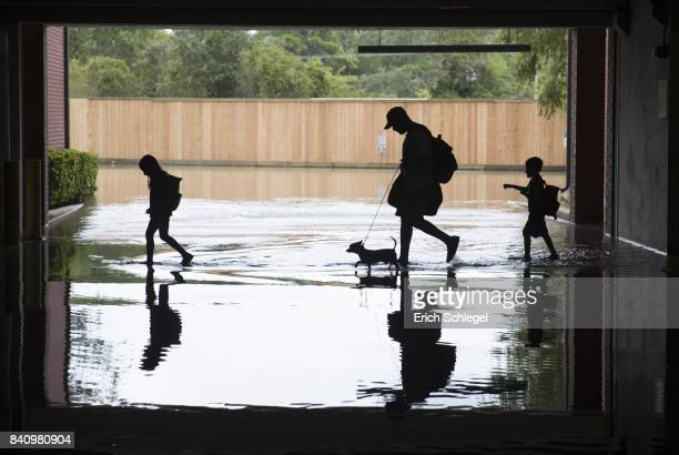 The Martinez family evacuates the apartment complex they live in near the Energy Corridor of west Houston, Texas where high water coming from the...