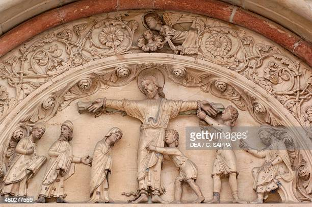 The Martyrdom of St Andrew relief by the school of Benedict Antelami the lunette above the central entrance to the Basilica of Sant'Andrea Vercelli...