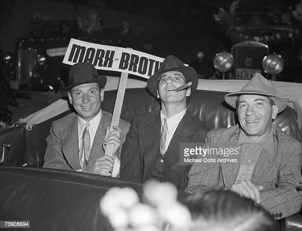 The Marx Bros L-R: Harpo Marx, Groucho Marx, Chico Marx at the Santa Claus Lane Parade circa 1938 in Los Angeles, California.