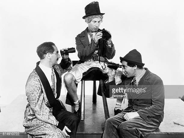 The Marx Brothers Groucho Harpo and Chico with binoculars