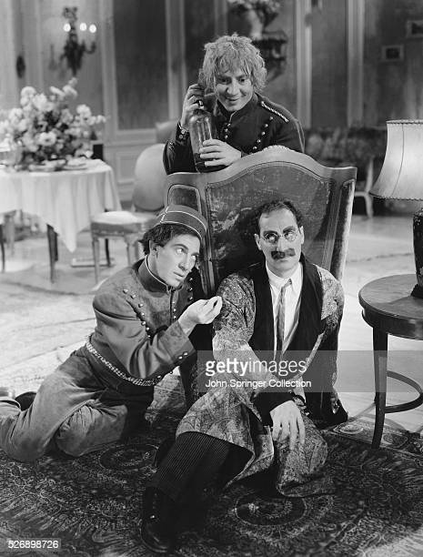 The Marx Brothers Harpo Chico and Groucho in their famous characters seen here from one of their movie's together Family of American comedians whose...
