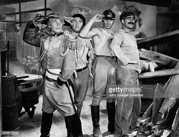 Harpo Chico Zeppo and Groucho Marx salute on the set of their classic 1933 film Duck Soup They play Pinky Lt Bob Roland Chicolini and Rufus T Firely...