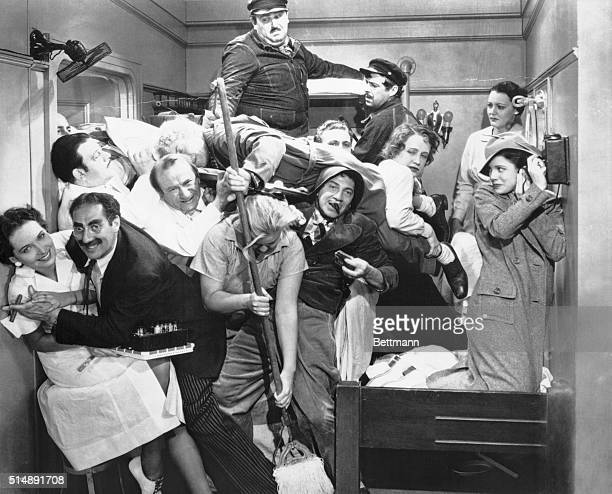 The Marx Brothers in one of their most popular films A Night at the Opera Groucho is second from left in foreground Harpo is of course lying across...