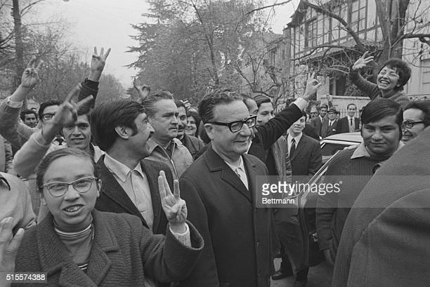 The Marxist candidate for the Chilean presidency Dr Salvador Allende is surrounded by supporters as he arrives at a polling station here Sept 4th The...